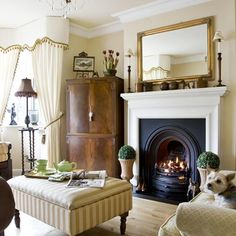 Carefully selected antiques are combined with a traditional window dressing and a period fireplace to create a classic living room scheme. A footstool doubles as a coffee table, while a tall corner unit has been converted from an old drinks cupboard into a TV cabinet. Yet with all the period elements here seen, there is still a contemporary edge that places the room firmly in the relaxed, family room category.