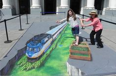 Awesome! 3D  sidewalk chalk illusion! If viewed from a different angle, you would see that it's totally flat! This is by Julian Beever, famous for his art.