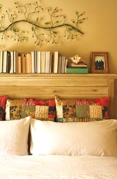 I'm not sure our headboard is wide enough for this... but I like the idea of a. using it for pretty storage and b. turning books backwards