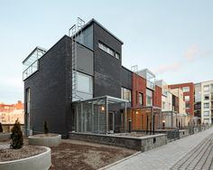Kalasataman Huvilat Townhouses / PORTAALI architects Ltd + ArkOpen Ltd