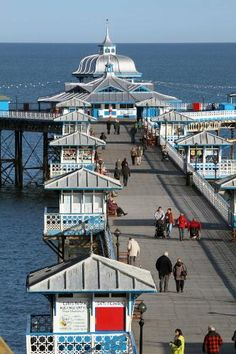 Llandudno pier, North Wales. Oh such happy days. Oh, I do like to be beside the sea side, Oh I do like to be beside the sea, Oh I do like to walk along the prom........... and so on......... and on ......... and on. rjp.