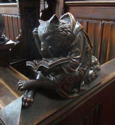 Fox doing some reading - statue in Dom Sv. Martina in Bratislava, Slovakia