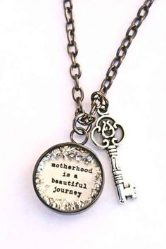 """This beautiful #necklace has a charm that reads 'Motherhood Is A Beautiful Journey'. It comes in standard 18"""" cable link chain. Available in gunmetal and silver plating. #jewelry #inspiration #quotes #motherhood"""