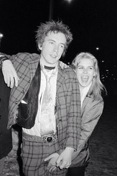 Johnny Rotten and Danielle Boothe in front of CBGB, Bowery, New York, 1978, Bobby Grossman.