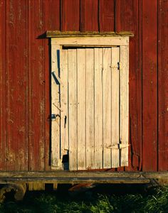old door on a barn. The opening of a new work day