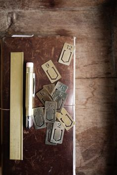 Because brass against leather looks so handsome!! What a great way to keep organized!