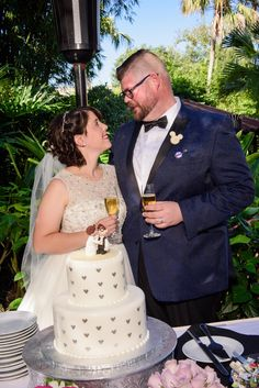 The bottom tier of Danielle and Nick's Disney wedding cake was red velvet, and the top tier was carrot cake. How cute is their Star Wars cake topper?