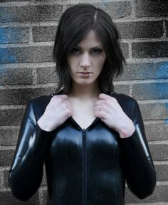 Gorgeous babe with stunning blue eyes wearing a leather catsuit
