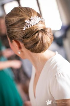 Bridal chignon hairstyle with white hairpiece at Willowdale Estate in Topsfield, MA Perfect for a Winter Wedding! http://www.willowdaleestate.com