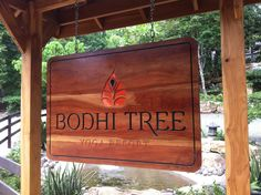 Carved and painted wood sign on a pochote wood board for Bodhi Tree - yoga resort, Nosara Costa Rica Forest Cottage, Timber Roof, Nosara, Bodhi Tree, Cottage Signs, Air Bnb, Painted Wood Signs, Costa Rica, Waterfall