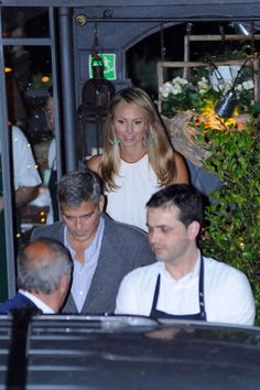 George Clooney and Stacy Keibler leaving restaurant Il Gatto Nero in Cernobbio, Como.  I think this was our waiter when we ate there last week!!!!