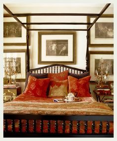 LOVE the coppery red with the sepia pictures and the deep brown wood.  Perfect