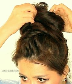 5 minute cute hairstyle! In this hair tutorial video, learn how to create a big, messy bun hairstyle with braids for medium long hair.