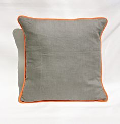 Grey linen cushion cover with fabulous orange neon piping. The cushion has an envelope fastening and fit cushion pads of 16 x 16 inches (40 x 40cms).