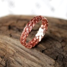 This ring is made out of many strands of fine copper wire, painstakingly woven in a fancy flat braid. I matched up the ends perfectly and soldered