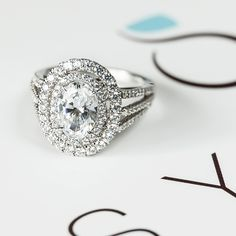 Why have one halo when you can have two?! This enchanting double-halo engagement ring will help persuade you!   sylviecollection.com (Style no. SY108)  #SylvieCollection #SomethingSylvie #GetEngagedWithSylvie #EngagementRing #Diamonds #Jewelry #RingOfTheDay #Fashion #Style #JewelryTrends