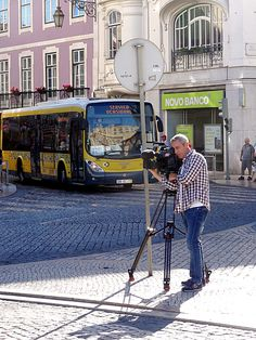 Lisboa Street View, man with camera shooting for television