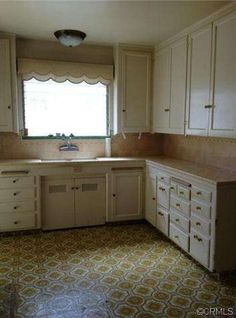 """1933 California Spanish Colonial with mostly original kitchen. Note the 3 pull out cutting boards and the kitchen sink cabinet with ventilated underset doors. Wall faucet (1960s """"Dishmaster?). 280 Granada Ave, Long Beach, CA 90803"""