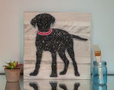 14x14 custom string art of your dogs breed with a collar.  Every piece is made to order and has its own unique characteristics including the
