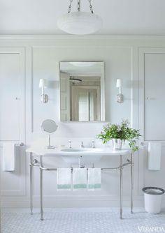 stunning sink vanity, all white bathroom
