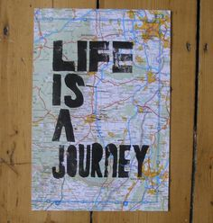 //I have a giant map! And I haven't known what to do with it. But this is what I need to do with it, apparently.//Life Is A Journey On A Recycled Atlas Page by nikimilns on Etsy