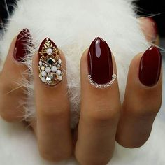 Short almond burgundy nail design with white rhinestones and stones! Beautiful nails by Ugly Duckling Exclusive Ambassadors and family members @home_of_deva ✨Ugly Duckling Nails page is dedicated to promoting quality, inspirational nails created by International Nail Artists #nailarta