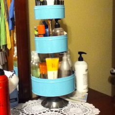 Organize your lotion with old cookie tins.  By Cathy Gough