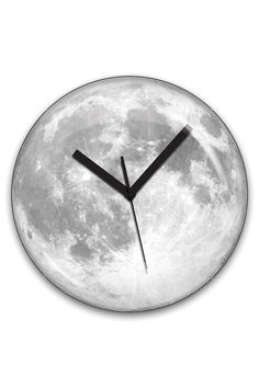 "Kikkerland Moon Clock // $32.99 // Two cool things about it: ""The face is an image mash-up of 65 different actual photographs of the moon.""  and ""The clock face glows for 2 hours after lights are off."" so it's probably better for the kitchen then the bedroom."