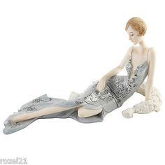 Blenheim Ladies Lady Laying With Feather Scarf Figurine