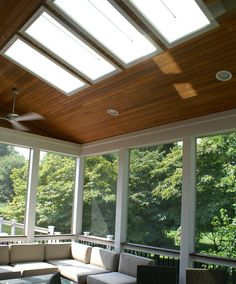 Modern screened in porch--sunlights, wood ceiling