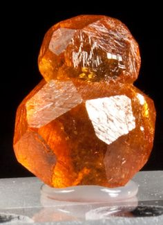 Spessartine Garnet, from Loliondo, near Serangeti National Park, Tanzania. A pair of stacked gem-like orange spessartine garnets. The bottom garnet is 1 cm in diameter.