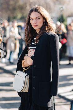 Black jacket and white bag