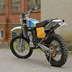 KTM's rip-snortin' dirt bikes rule the roost off road. But the razor-edged styling is not to everyone's tastes. This vintage-flavored KTM 450 EXC is the work of master custom motorcycle builder Walt Siegl, and we're in love.