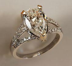 White & Gold Pear Shape Diamond Ring
