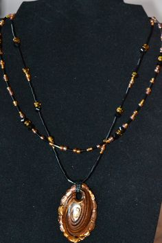 Bronzy Gold and Black double strand necklace with pendant.  Necklace is convertible!  Change the look with one simple trick!