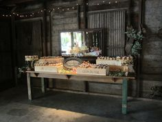 Cupcakes displayed on wine boxes on our farm table ~ a beautiful display of wedding goodies.