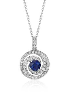 Elegant in design, this pendant features a vibrant round blue sapphire gemstone surrounded by sparkling micropavé diamonds