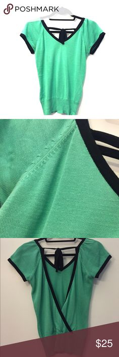 XS Mint green, black trimmed short sleeve sweater. Amazing back detail, cute and fashionable mint green short sleeve sweater. In good condition. Urchin Tops Tees - Short Sleeve