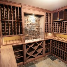 Our custom temperature and humidity controlled walnut wine room is wrapped up and ready to be stocked, at over 850 bottle capacity - that's no small feat. The wine room is completed with a dry stacked stone and slate flooring. LED lighting was used to ensure a consistent temperature. #cheers #vino #wine #wineroom #cellar #customhome #designbuild #walnut #millwork #slate #LED #galleconstruction
