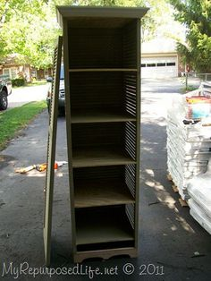 old shutters used to create a book case..or with a door a storage cabinet..love the look.....