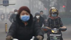 Cyclists riding through Beijing smog. Polluted air causes 5.5 million deaths a year new research says. The main culprit is the emission of small particles from power plants, factories, vehicle exhausts and from the burning of coal and wood.