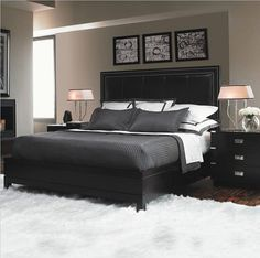 Headboard, nightstand, pictures above bed
