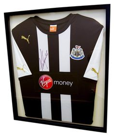 We can even frame signed shirts, such as this football top. This has been framed to look like a t-shirt still, however we can frame just the signed areas if that is what you require.