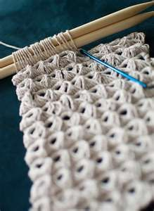 add more knitting needles (or use a ruler?) to make larger loops (broomstick)