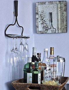 Us on old rake to hold your wine glasses or cups. Great idea for small wet bars and limited spaces