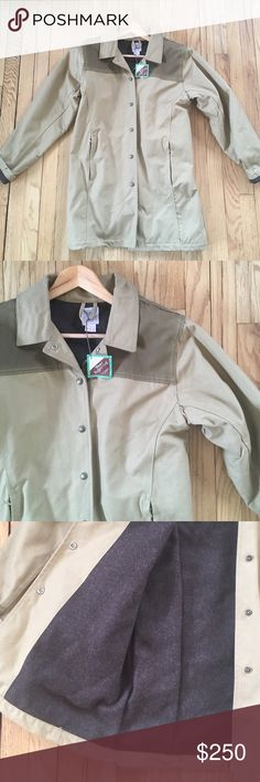 "NWT Filson Women's Twill Wool Lined Jacket Medium NWT Filson Women's Twill Wool Lined Jacket in tonal tan with heathered brown wool lining. This coat is GORGEOUS, classic and WARM! Size Medium, 20"" armpit to armpit, 31.5"" shoulder to hem, 25.5"" sleeve. 100% cotton twill, 100% wool lining. Two front zippered pockets, snap front, adjustable snap at back waist to create a tailored look. Excellent condition. No trades, bundle discount available! Filson Jackets & Coats Utility Jackets"