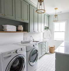 Well appointed gray green laundry room