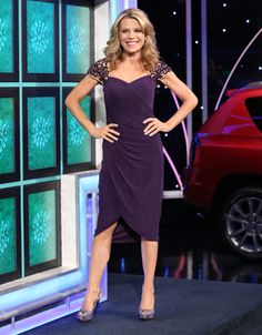 LA FEMME Plum jersey cocktail dress w/nude illusion and plum beaded lace shoulders & cap sleeve, v-neck bodice w/diagonal pleating, wrap skirt w/slit at right  | Vanna White's dresses | Wheel of Fortune