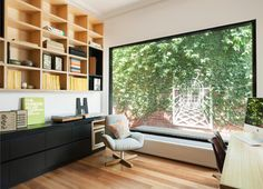 The window reveals a clever lattice feature on the wall outside that creates the illusion of a distant scene. It not only opens up the space but adds a tranquil quality to it.  ....Balaclava House - contemporary - Home Office - Melbourne - ArchiBlox