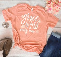 Items similar to Grace Wins Every Time with Flowers // Heather Sunset Tee // Christian Faith Shirt on Etsy Vinyl Shirts, Mom Shirts, Cute Shirts, Funny Shirts, Mothers Day Shirts, Grace Wins, Look T Shirt, Christian Shirts, Christian Apparel